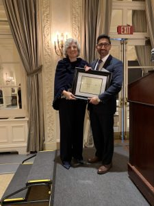Dr. Diane LoRusso recieving Citation recognizing her 50 years in medicine from Westchester County Medical Society's President Omar Syed at the society's 2019 Annual Meeting