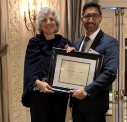 Dr. Diane LoRusso receiving Citation recognizing her 50 years in medicine from Westchester County Medical Society's President Omar Syed at the society's 2019 Annual Meeting